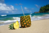 Pina colada with pipe on beach — Stock Photo