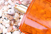 Parfum on cockleshells — Stock Photo