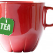 Little red tea cup with teabag (clipping — Stock Photo