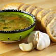 Soup, bread and garlic - Stock Photo