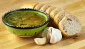 Soup, bread and garlic — Stock Photo