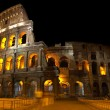 Coliseum at night - Stock Photo