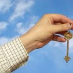 Holding a key — Stock Photo