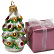 Present box and a Happy New Year tree de — Stock Photo