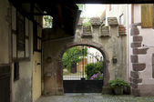 Riquewihr gate and house fragment — Stock Photo