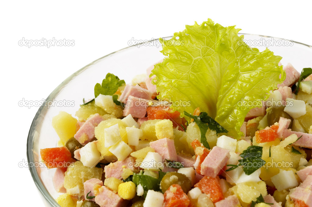 Russian salad (Olivie) isolated over glass bowl — Stock Photo #1564390