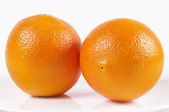 Two whole oranges — Stock Photo