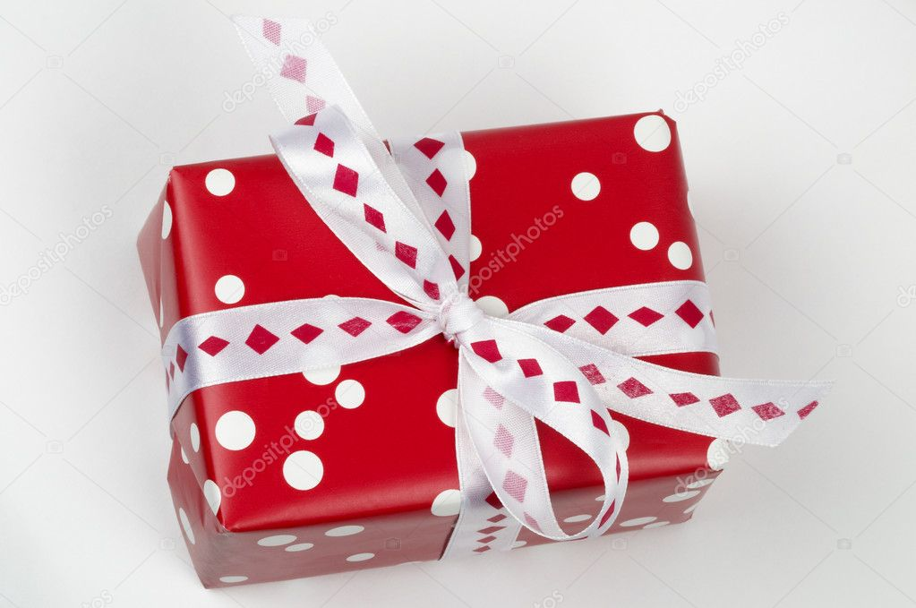 Little present box with ribbon bow isolated over grey background — Stock Photo #1824590