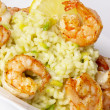 Risotto with fried prawns and avocado - Stock Photo