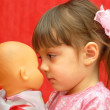 The girl and a doll — Stock Photo