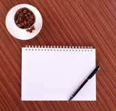 Pen,notebook and coffee — Stock Photo