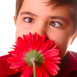 Teen and red flower — Stock Photo