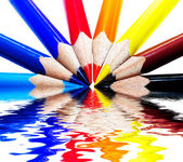 Colored pencils in water — Stock Photo