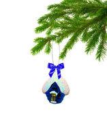 Christmas toy house on tree — Stock Photo