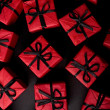 Red gift boxes on black — Stockfoto