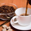 Stock Photo: Cup of coffee, sugar and beans
