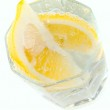Glass with soda water and lemon slices — Stock Photo