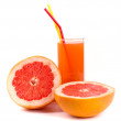 Grapefruit and juice in glass — Stock Photo