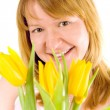 Woman with yellow tulips - Stock Photo