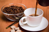 Cup of coffee, sugar and beans — Stock Photo