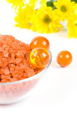 Bath salt, oil balls in a bowl and yello — Stock Photo