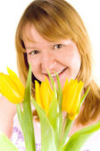Woman with yellow tulips — Stock Photo