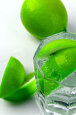 Water with lime slices — Stock Photo