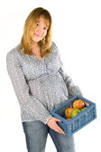 Pregnant woman with apples — Stock Photo