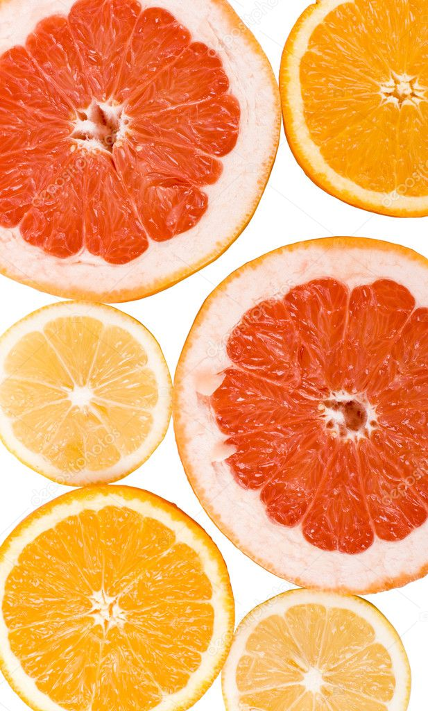 Slices of an lemon, orange and grapefruit background — Stock fotografie #1038194