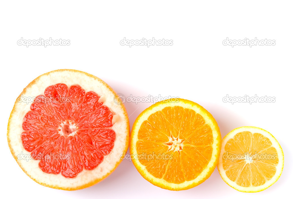 Slices of an lemon, orange and grapefruit on white background — Stock Photo #1038228