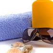 Royalty-Free Stock Photo: Towel, sunglasses and lotion