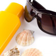 Sunglasses and lotion — Stock Photo