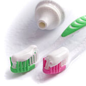 Toothpaste and toothbrushes — Stock Photo