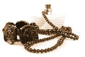 Necklace, bracelet and parfume bottle — Stock Photo