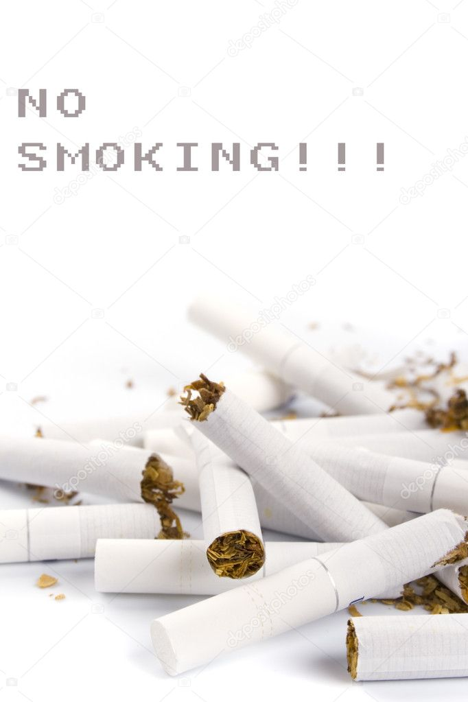 Broken cigarettes closeup on white background — Stock Photo #1040073