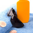 Stock Photo: Towel, sunglasses and lotion