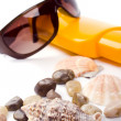 Shells, sunglasses and lotion — Stock Photo