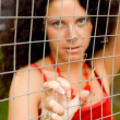 Woman behind a lattice — Stock Photo