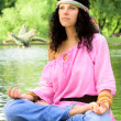 Hippie woman meditating — Stock Photo