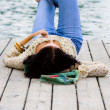 Woman lying near the river — Stock Photo #1072395