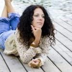 Woman lying near the river — Stock Photo #1072438