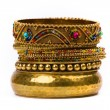 Stock Photo: Stack of golden bracelets
