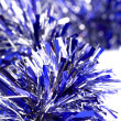 Blue christmas tinsel - Stock Photo