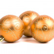 Three golden christmas balls — Stock Photo