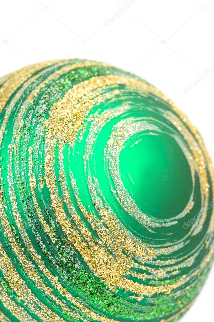 Green glass christmas ball closeup on white background — Stock Photo #1074109