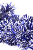 Blue christmas tinsel — Stock Photo