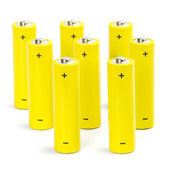 Eight yellow alkaline batteries — Stock Photo