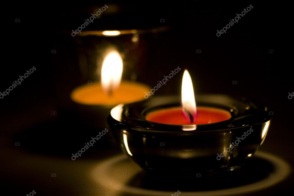 Two candles flaming in the dark — Stock Photo #1182009