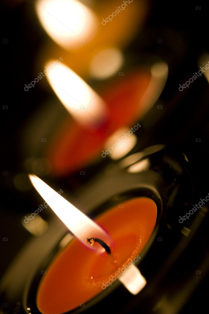 Three candles flaming in the dark closeup  Stock Photo #1223160