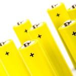 Eight yellow alkaline batteries — Stock Photo
